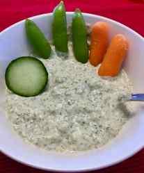 Image of vegan tzatziki dip with vegetables.