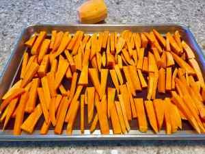 sweet potato fries in sticks ready for baking