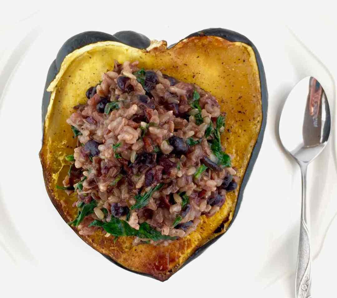 vegan garam masala cranberry rice stuffed acorn squash