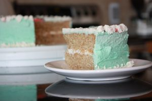 a slice of healthy aqua faba vanilla cake with whole wheat and vegan frosting