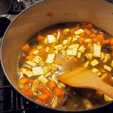 Add diced carrots and diced plantain + 750ml. vegetable stock