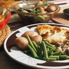 pithivier served hot with green beans and potatoes