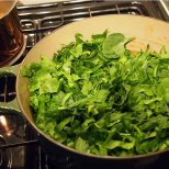 slice the spinach into ribbons and lay over the cooked beans - cover and cook 10 mins.