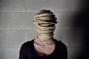 Ropes around a woman's head