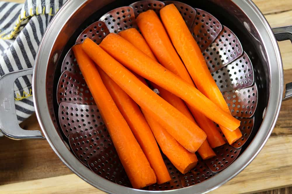 Carrots in a steamer basket.