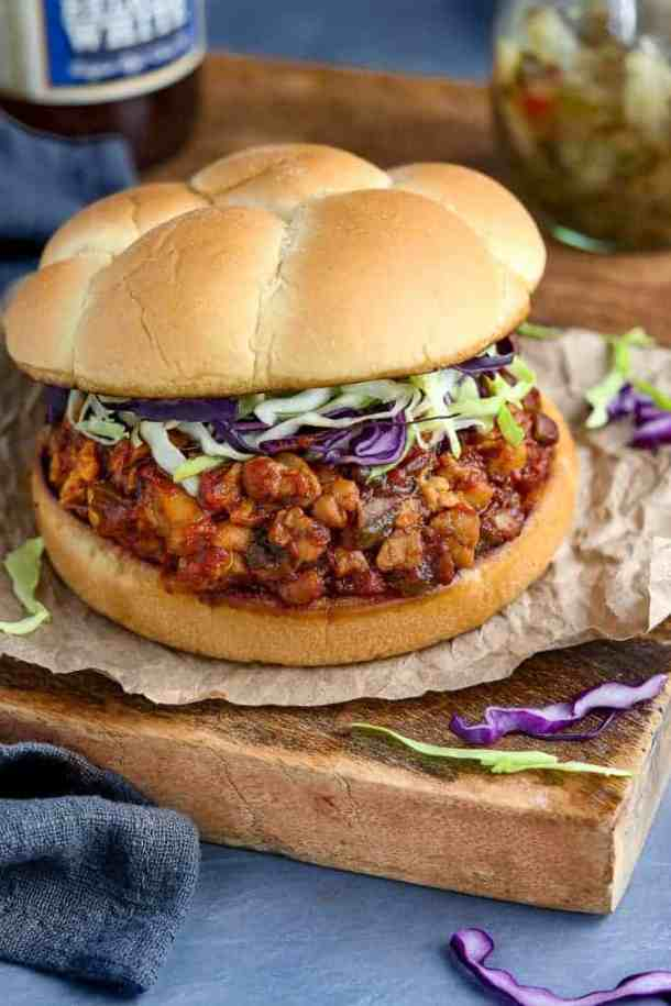 Overhead view of sloppy joe sandwich on a wooden board with cabbage on the side.