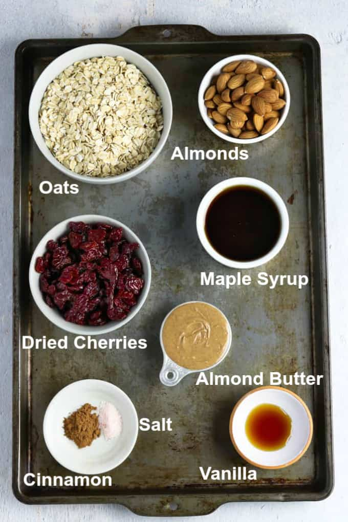 Baking sheet of ingredients to make vegan granola recipe.