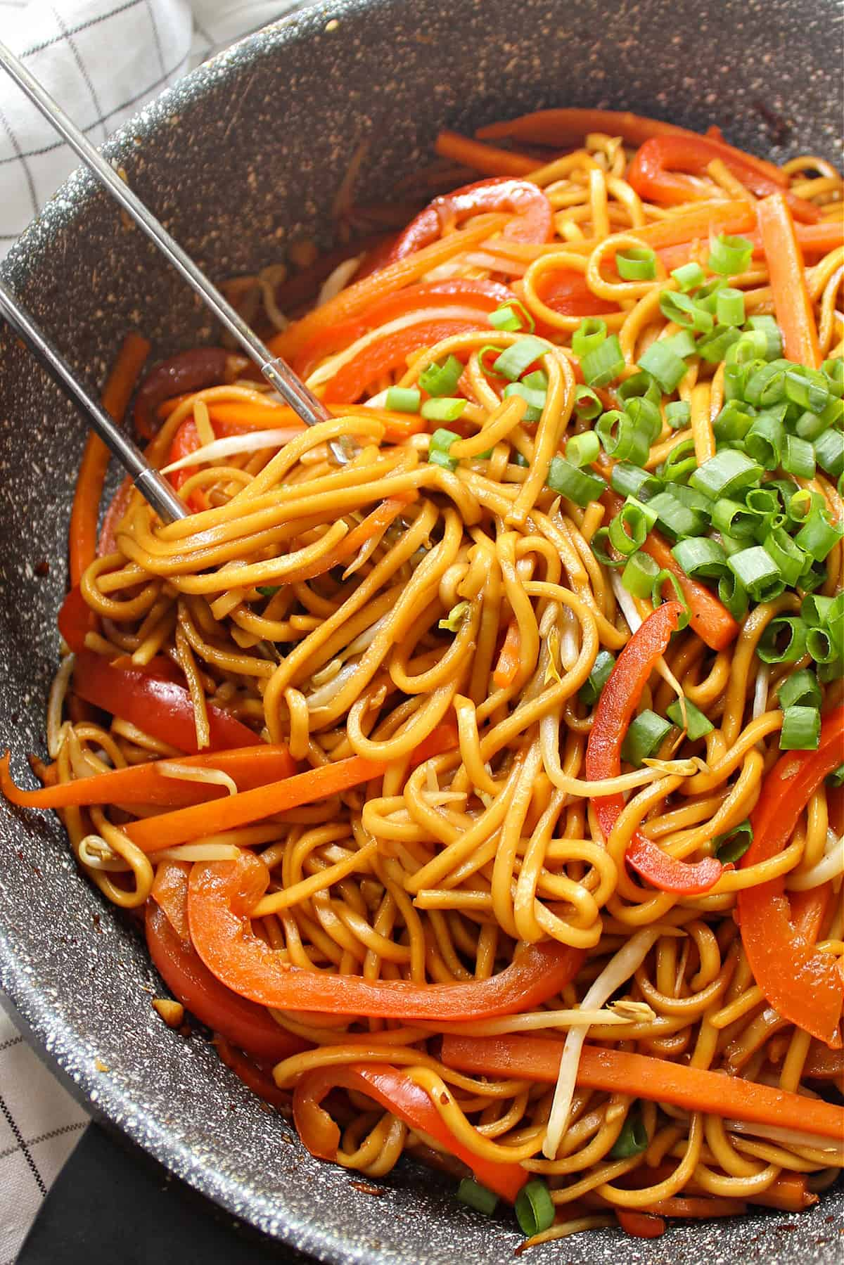 Closeup view of lo mein in a wok.