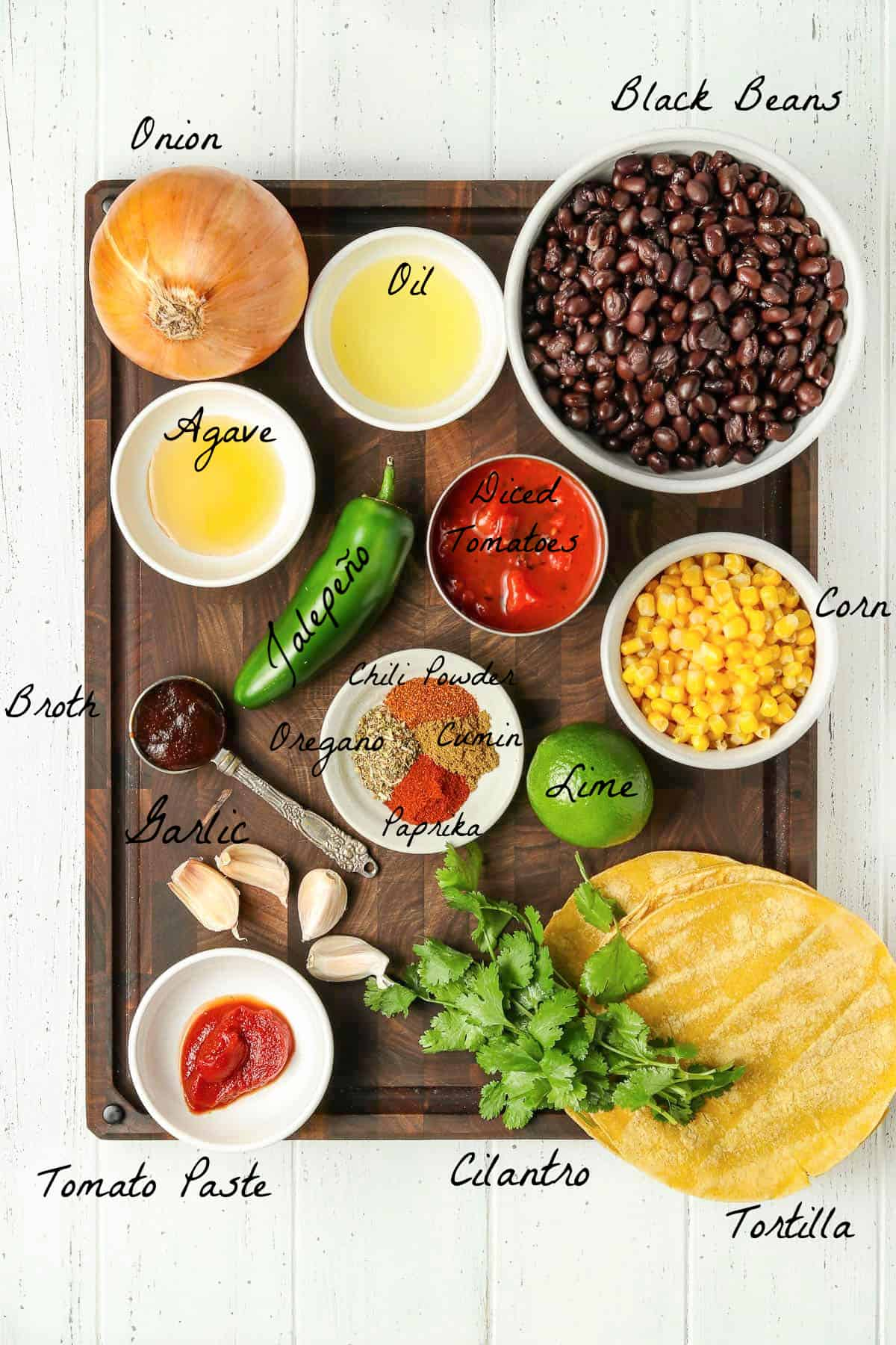 Ingredients to make the recipes on a wood cutting board.