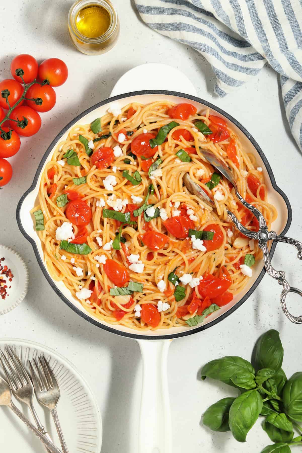 overhead view of cherry tomato pasta in a white skillet.