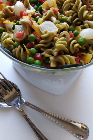 Vegan Pasta Salad served in a bowl with spoon and fork on the side