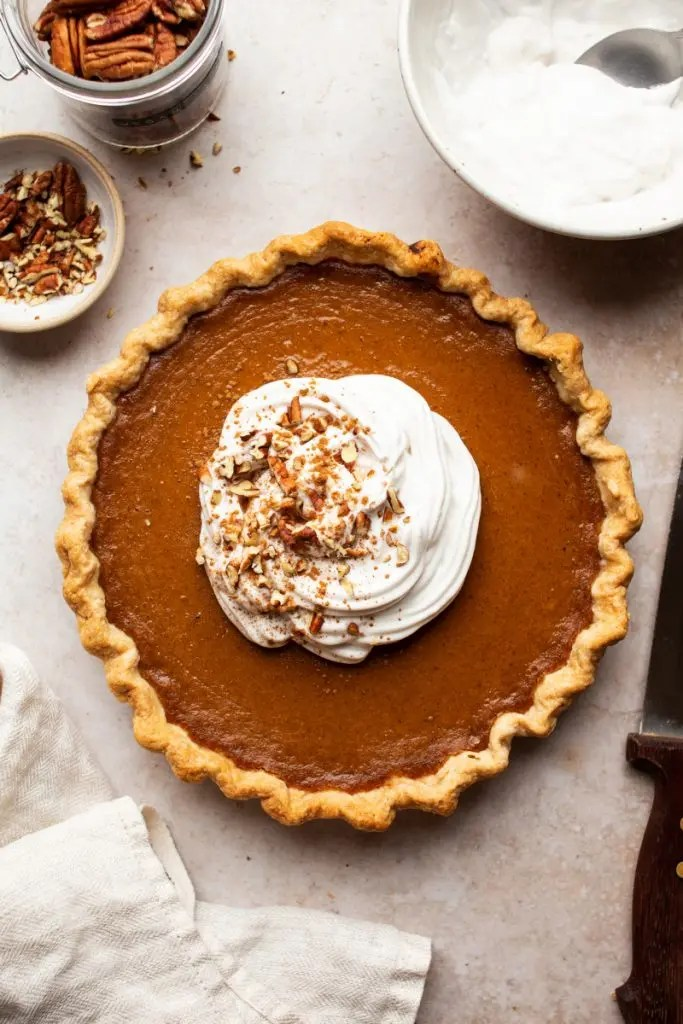 Whole pumpkin pie with whipped cream on top