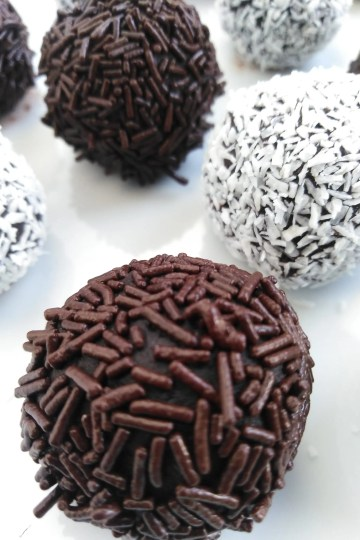 Rolled chocolate truffles covered in dark chocolate sprinkles and coconut