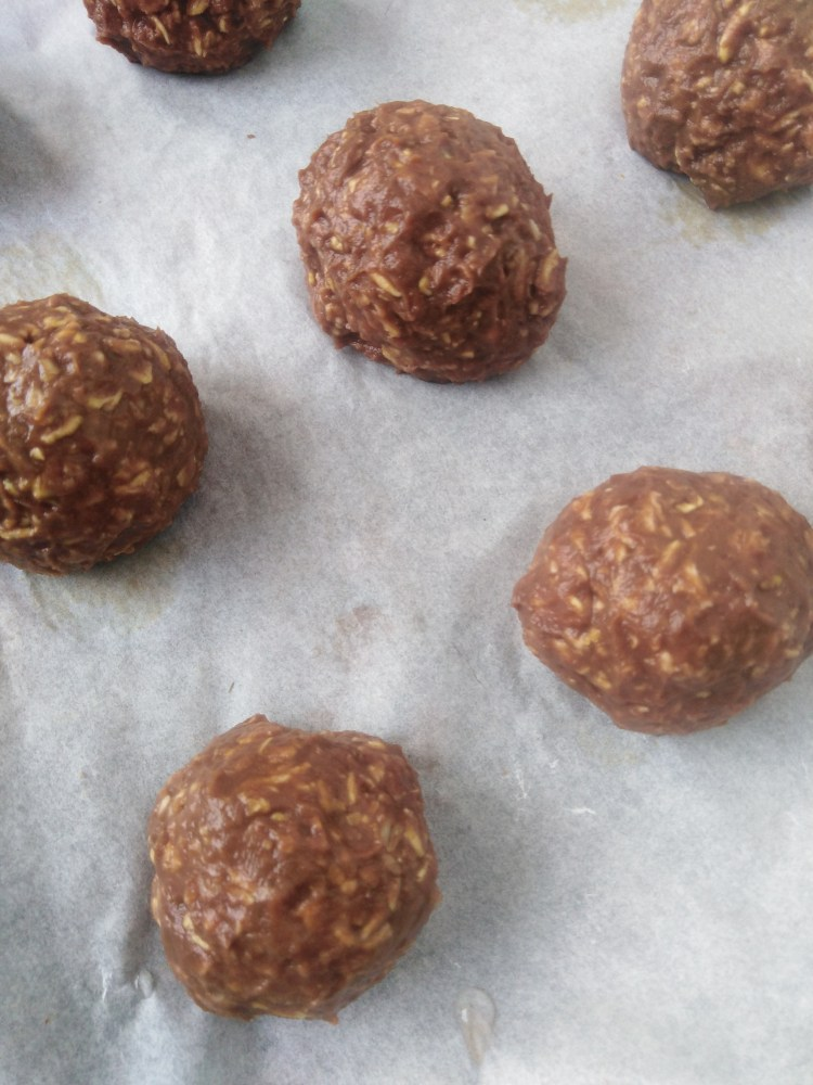 sweet potato cookies molded into balls on parchment paper
