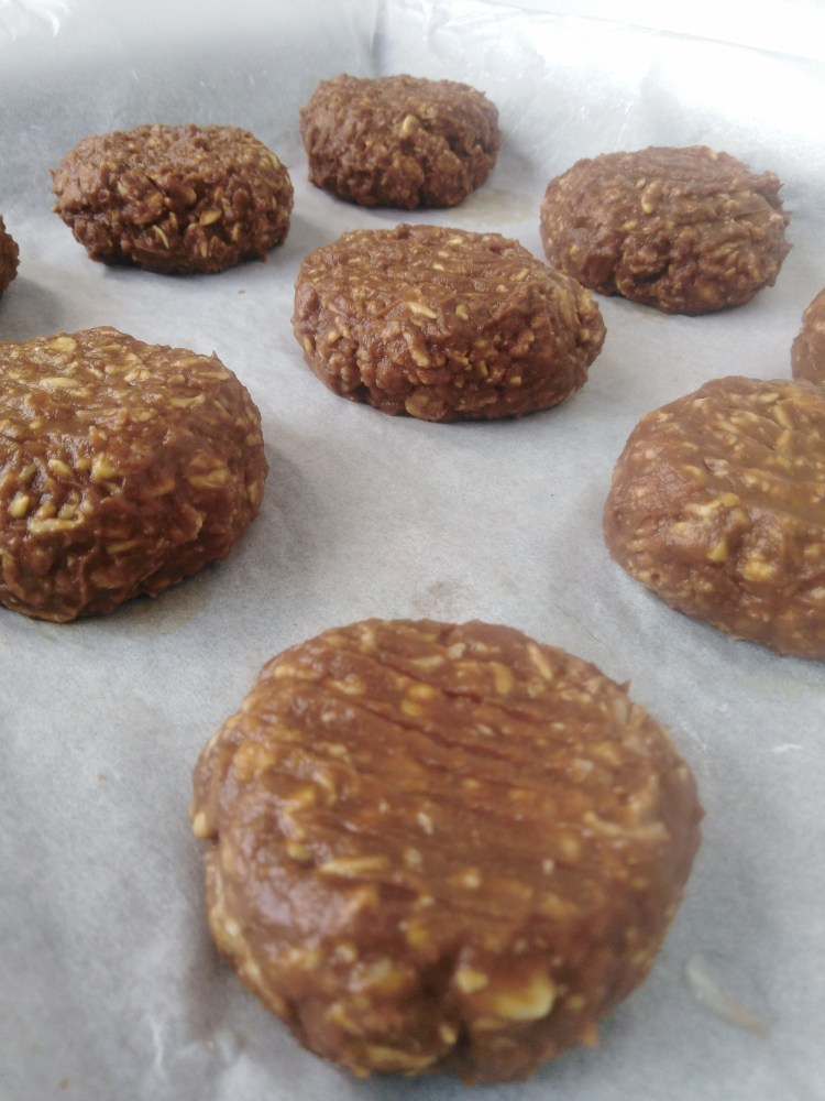 sweet potato cookies molded into balls and flattened on parchment paper