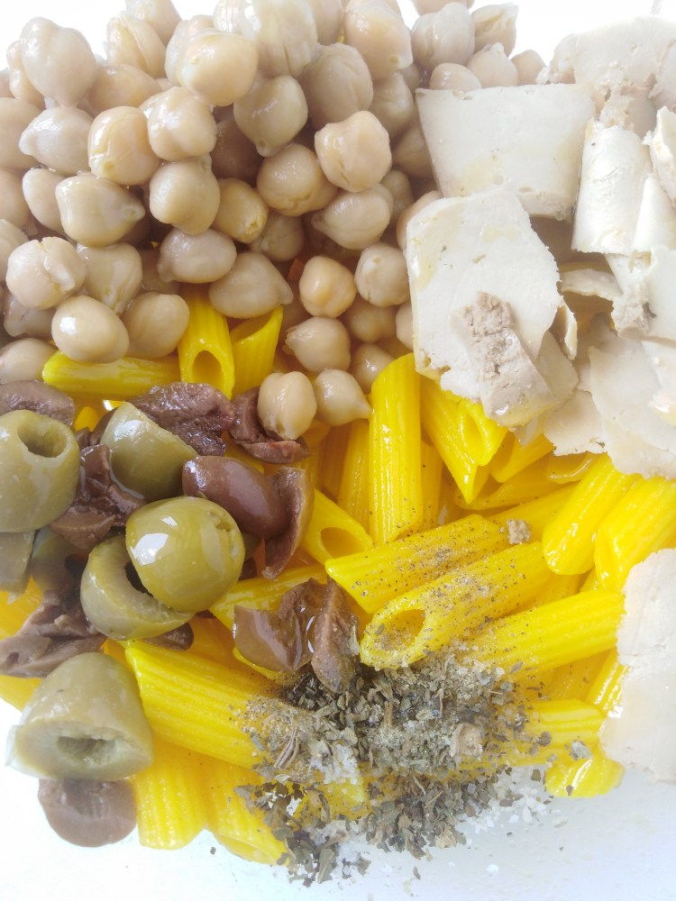 ingredients inside a bowl ready to be mixed with the pasta to make turmeric pasta with chickpeas