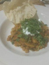 Chickpea dahl with coconut yoghurt, poppadom and coriander