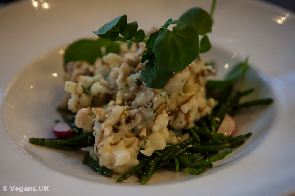 Steamed cauliflower with cashew 'cheese' sauce
