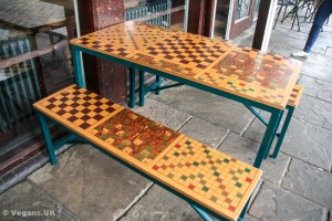 Chess board outside tables