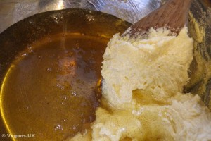 Adding in the syrup to the creamed mixture