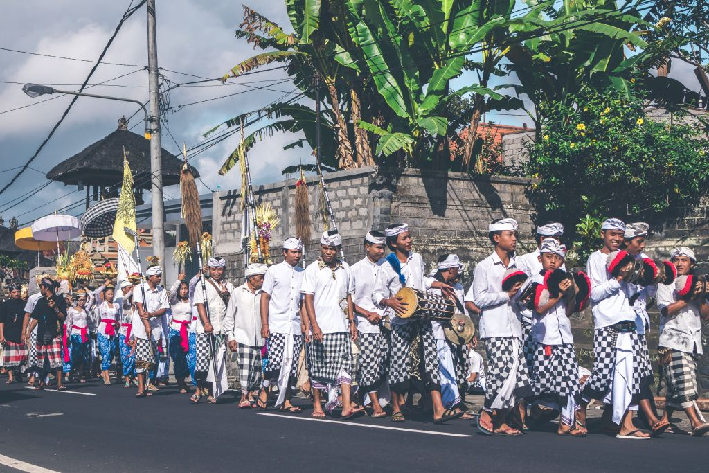 cost of living in Bali - Balinese locals gathered together