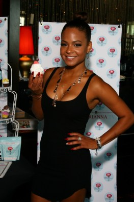 Christina Milian all smiles while showing off Beauty Kitchen soap cupcake at GBK 2014 Espy Gifting Suite Party
