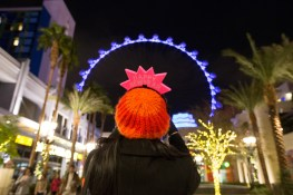 A visitor at The LINQ Promenade snaps a photo of the High Roller during New Year's Eve.