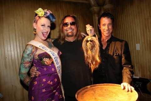 Vince Neil, Tana the Tattooed Lady, and Tony Felicetta celebrate Neil's shrunken head at The Golden Tiki.