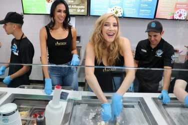 Fantasy girls laugh over rolled ice cream