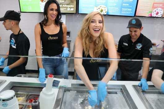 Fantasy girls laugh over rolled ice cream