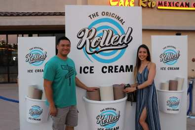 Guests pose in front of lifesize Rolled Ice Cream