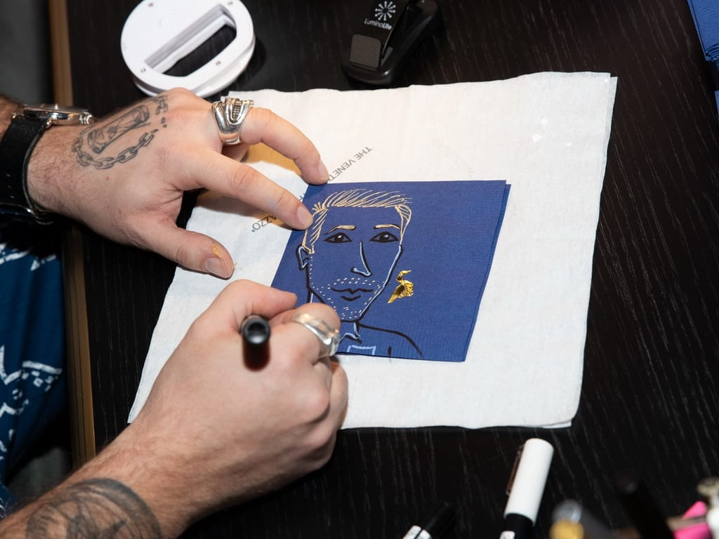 Napkin Killa creates a custom sketch of Justin Hartley at the Mott 32 grand opening celebration at The Venetian Resort Las Vegas, 12.28.18_Credit Erik Kabik