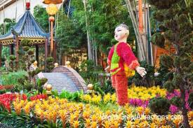 Chinese New Year decorations at Bellagio Gardens and Conservatory 2015 - Kid in front of a small bridge over a small stream