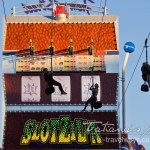 Photo: Slotzilla Zipliners zipping down from the largest slot machine in the world