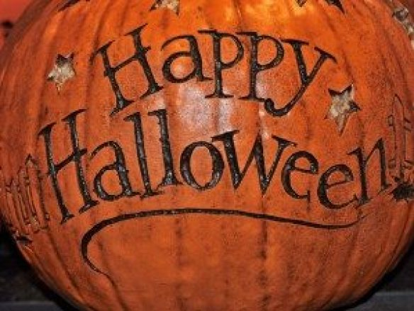 Pumpkin with the words Happy Halloween carved into it