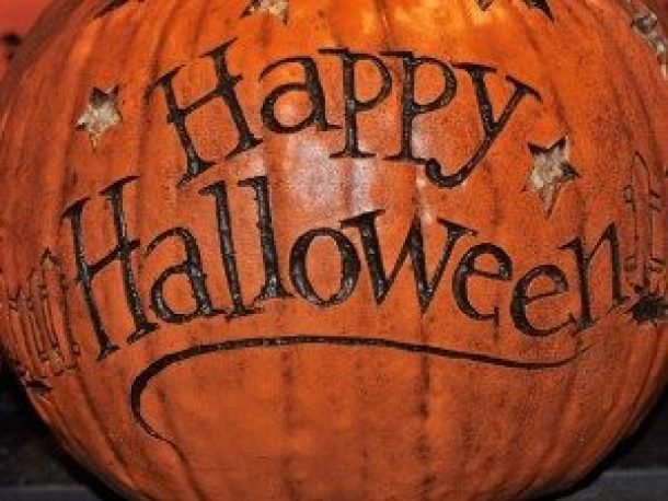 Pumpkin carved with the words Happy Halloween