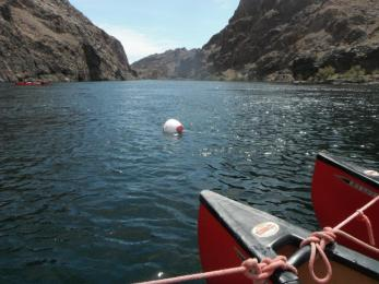 Tips of canoes on the water between mountains Lake Mead