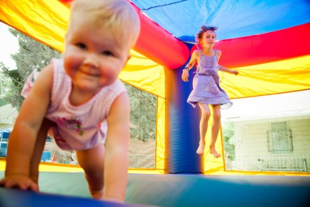 Kids Playing in bounce house, baby smiling