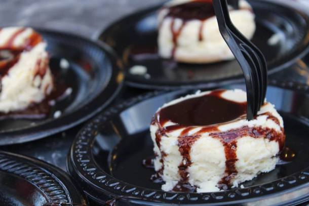 Mini cheesecake desserts with chocolate sauce from San Gennaro Feast