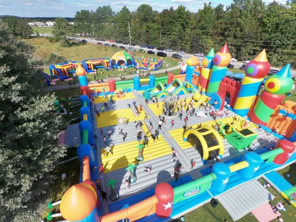The Big Bounce giant bounce house aerial view showing kids all over.