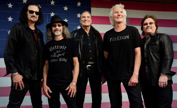 Grand Funk Railroad in front of American flag