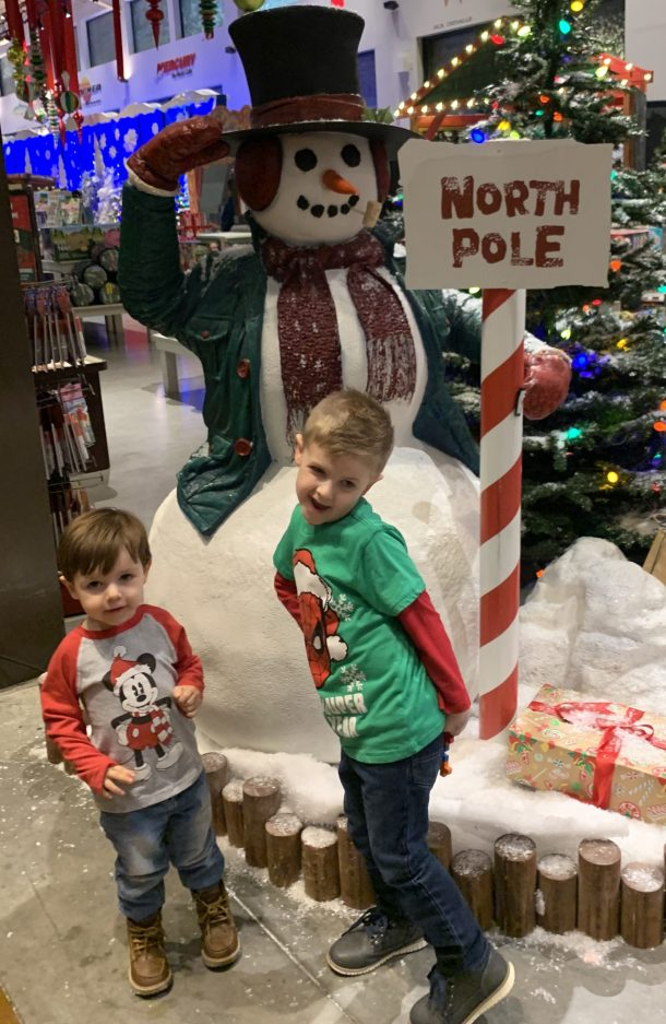 Two small boys in front of Santa's Wonderland at Bass Pro Shops