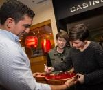 Rock duo Tegan and Sara sign a guitar at new Memorabilia Showcase in Hard Rock Hotel Las Vegas