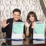 Donny Osmond and Marie Osmond with hand impressions