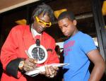 "Flavor Flav signs autographs at ""House Of Flavor"" BBQ Restaurant"