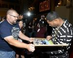 New England Patriots' Malcom Butler signs autograph for a fan inside Chateau Nightclub in Las Vegas