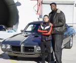 Professional bodyguard Derrick Goode guards Mike Hammer and his car