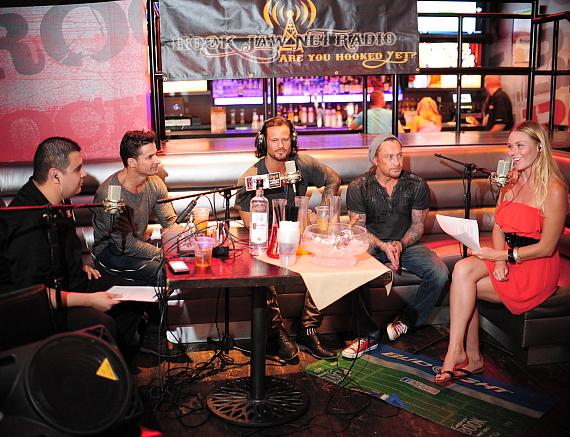 "Cast members of Thunder from Down Under with co-host Christina ""CC"" Christensen at PBR Rock Bar"