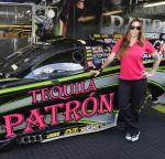 Alexis DeJoria poses with the 10,000-horsepower Kalitta Motorsports Tequila Patrón Toyota Camry Funny Car