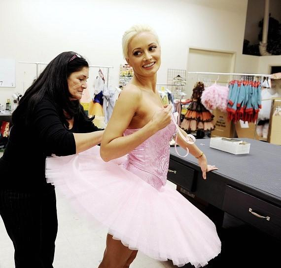 Madison laces up pointe shoes